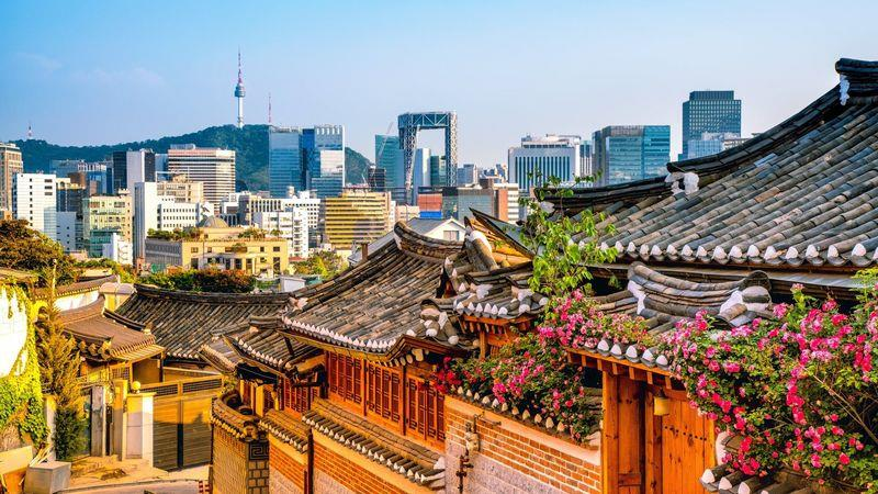 Bukchon Hanok village against the Seoul skyline