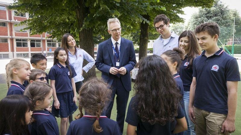 British School of Milan principal Chris Greenhalgh with pupils