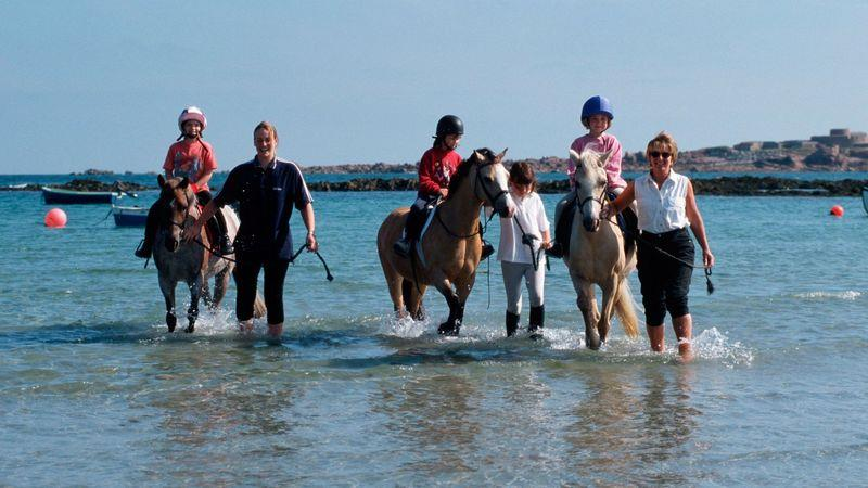 Vazon Bay is a popular spot for surfing and horseriding