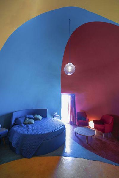 ZAV Architects Built Colorful-Domed Housing Made Of Rammed Earth And Sand On Hormuz Island, Iran