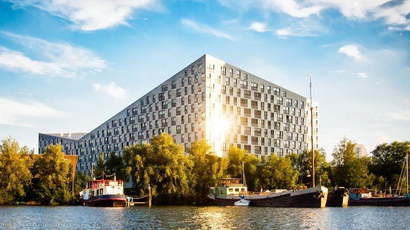 Apartment building in the Eastern Docklands in Amsterdam, The Netherlands. This was built as part of an urban renewal program from the 1990's to 2010. Photo: Dreamstime