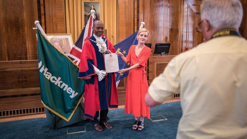 Elsa Court receives her certificate of naturalisation