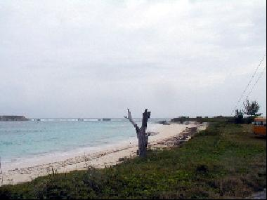 Acreage with beach and road frontage