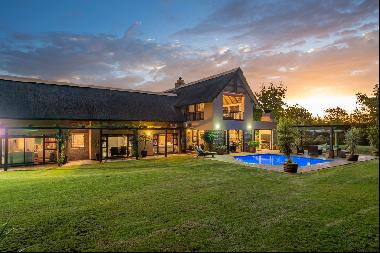 Paradise exists in this magnificent family home bordering the Helderberg Nature Reserve