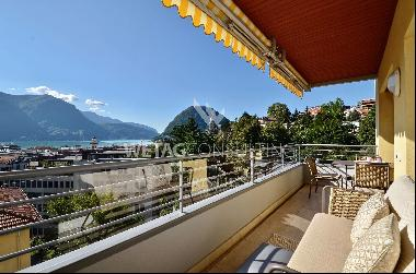 Modern apartment for sale, very centrally located and with breathtaking Lake Lugano view