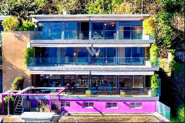 Lugano-Melide: modern penthouse apartment with a magical view of Lake Lugano for sale