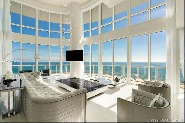 This unique duplex completely renovated offer a panoramic views of South Beach