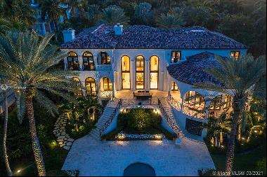 beautiful Bayfront Mediterranean estate, located behind the gates of the exclusive Tahiti
