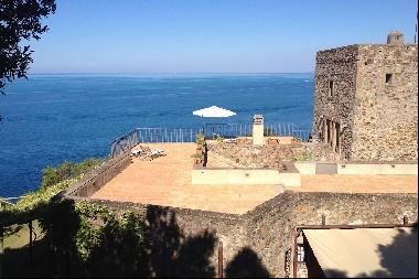 Ancient watchtower of the 15th century on a cliff directly overlooking the sea