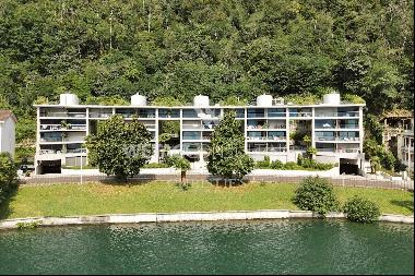 Modern apartment for sale in Lugano-Melide with breathtaking views of Lake Lugano